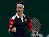 Kei Nishikori of Japan celebrates his win against Grigor Dimitrov of Bulgaria during day two of the Shanghai Rolex Masters at the Qi Zhong Tennis Center on October 8, 2013