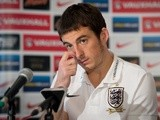 England football squad member Leighton Baines speak to journalists during a press conference at the Grange Hotel near Watford, England, on October 13, 2013