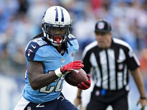 Chris Johnson #28 of the Tennessee Titans runs the ball against the New York Jets at LP Field on September 29, 2013
