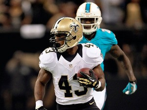 Darren Sproles #43 of the New Orleans Saints runs for yards against the Miami Dolphins during a game at the Mercedes-Benz Superdome on September 30, 2013