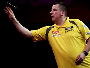 Dave Chisnall of England in action during his second round match on day eight of the 2013 Ladbrokes.com World Darts Championship at the Alexandra Palace on December 21, 2012