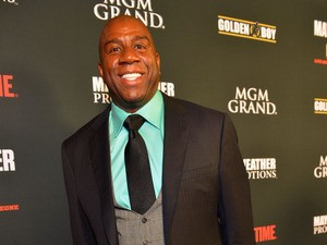 NBA Hall of Fame member and Los Angeles Dodgers part owner Earvin 'Magic' Johnson arrives at the MGM Grand Garden Arena for the Floyd Mayweather Jr. vs. Canelo Alvarez boxing match on September 14, 2013