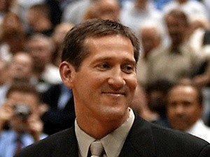 Former Utah Jazz player Jeff Hornacek looks at his framed jersey during a cerermony to retire his number on 19 November, 2002
