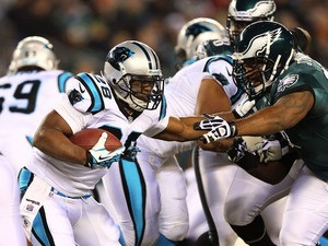 Jonathan Stewart #28 of the Carolina Panthers carries the ball as Cullen Jenkins #97 of the Philadelphia Eagles defends on November 26, 2012