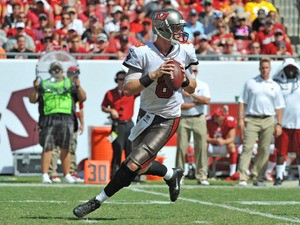 Quarterback Mike Glennon #8 of the Tampa Bay Buccaneers sets to pass against the Arizona Cardinals September 29, 2013
