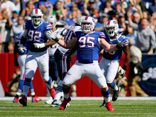 Kyle Williams #95 of the Buffalo Bills celebrates sacking Tom Brady #12 of the New England Patriots (not shown) at Ralph Wilson Stadium on September 8, 2013