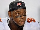 Defensive end Da'Quan Bowers of the Tampa Bay Buccaneers watches play against the Washington Redskins August 29, 2013