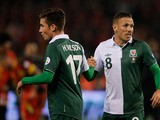 Craig Bellamy and Harry Wilson of Wales shake hands after the FIFA 2014 World Cup Qualifying Group A match between Belgium and Wales at King Baudouin Stadium on October 15, 2013