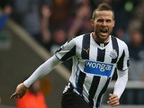 Yohan Cabaye of Newcastle United celebrates scoring their first goal during the Barclays Premier League match between Newcastle United and Liverpool at St James' Park on October 19, 2013