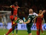 Romelu Lukaku of Belgium and James Collins of Wales stretch for the ball during the FIFA 2014 World Cup Qualifying Group A match on October 15, 2013