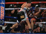 Ruslan Provodnikov (L) of Russia knocks down Mike Alvarado (R) on the ropes in the eighth round at the 1stBank Center on October 19, 2013