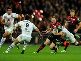 Chris Ashton of Saracens is challenged by Jean-Marc Doussain of Toulouse during the Heineken Cup pool three match between Saracens and Toulouse at Wembley Stadium on October 18, 2013