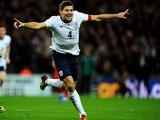 Steven Gerrard wheels away in celebration after scoring the second goal at Wembley against Poland to secure England's place in the 2014 World Cup on October 15, 2013