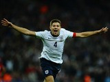 Steven Gerrard of England celebrates scoring the second goal during the FIFA 2014 World Cup Qualifying Group H match between England and Poland at Wembley Stadium on October 15, 2013
