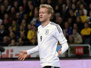 Germany's Andre Schurrle celebrates after scoring during the FIFA 2014 World Cup group C qualifying football match against Sweden on October 15, 2013