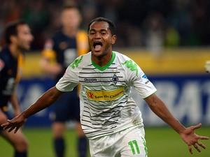 Borussia Moenchengladbach's Raffael celebrates scoring against Eintracht Braunschweig on September 20, 2013