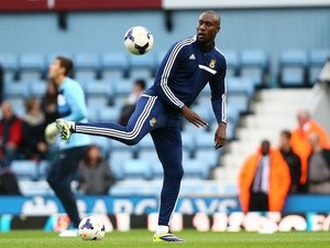 Carlton Cole of West Ham United warms up ahead of the Barclays Premier League match between West Ham United and Manchester City at the Boleyn Ground on October 19, 2013