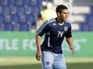 Dom Dwyer #14 of Sporting Kansas City handles the ball during warm up before a game against FC Dallas at Livestrong Sporting Park on March 25, 2012