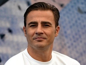 Former Italian football captain Fabio Cannavaro attends a promotional event for the Tiger Street Football in Singapore on October 17, 2013