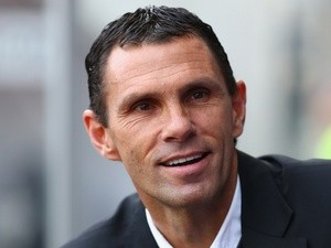 New Sunderland boss Gus Poyet looks on from the dugout during the Barclays Premier League match between Swansea City and Sunderland at the Liberty Stadium on October 19, 2013