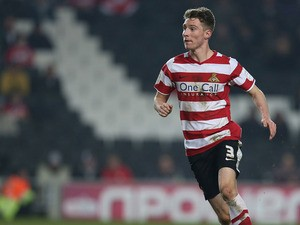 James Husband of Doncaster Rovers in action during the npower League One match between MK Dons and Doncaster Rovers at Stadium MK on March 5, 2013