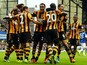 Hull City's players celebrate with Ivorian striker Yannick Sagbo (3rd R) after scoring his team's first goal during the English Premier League football match between Everton and Hull City at Goodison Park in Liverpool, northwest England, on October 19, 20