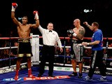 Anthony Joshua celebrates his victory over Paul Butlin during their Heavyweight bout at Motorpoint Arena on October 26, 2013
