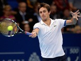 Edouard Roger-Vasselin in action against Daniel Brands during their Swiss Indoors quarter-final tennis match on October 25, 2013