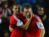 Jay Rodriguez of Southampton celebrates scoring their second goal with Rickie Lambert of Southampton during the Barclays Premier League match against Fulham October 26, 2013