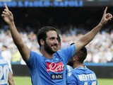 SSC Napoli's forward Gonzalo Higuain celebrates after scoring during the Italian Serie A football match SSC Napoli vs Torino FC in San Paolo Stadium on October 27, 2013