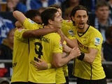 Dortmund's Pierre-Emerick Aubameyang is congratulated by team mates after scoring the opening goal against Schalke on October 26, 2013