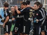 Reims' players celebrate after scoring a goal during the French L1 football match between Marseille and Reims at the Velodrome stadium in Marseille on October 26, 2013