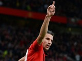 Manchester United's Dutch forward Robin van Persie celebrates scoring his team's first goal during the English Premier League football match against Stoke City on October 26, 2013