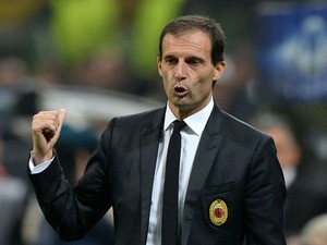 Head coach AC Milan Massimiliano Allegri reacts during the UEFA Champions League Group H match between AC Milan and Barcelona at Stadio Giuseppe Meazza on October 22, 2013
