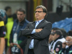 Head coach FC Barcelona Gerardo Martino reacts during the UEFA Champions League Group H match between AC Milan and Barcelona at Stadio Giuseppe Meazza on October 22, 2013
