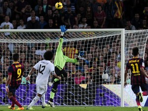 Barcelona's Chilean forward Alexis Sanchez scores past Real Madrid's goalkeeper Diego Lopez during the Spanish league Clasico football match FC Barcelona vs Real Madrid CF on October 26, 2013