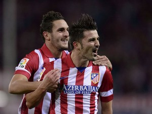 Atletico Madrid's forward David Villa celebrates after scoring during the Spanish league football match Club Atletico de Madrid vs Betis at the Vicente Calderon stadium in Madrid on October 27, 2013