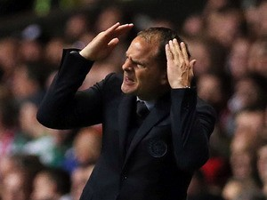 Ajax's head coach Frank de Boer gestures during the UEFA Champions League Group H football match between Celtic and Ajax at Celtic Park in Glasgow, Scotland, on October 22, 2013