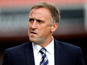 Cheltenham manager Mark Yates looks on prior to the Sky Bet League Two match between Cheltenham Town and AFC Wimbledon at The Abbey Business Stadium on September 28, 2013
