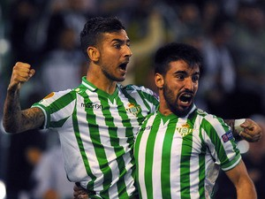 Betis' midfielder Alvaro Vadillo celebrates with Betis' forward Chuli after scoring during the UEFA Europa league Group I football match Real Betis vs Vitoria Guimaraes at the Benito Villamarin stadium in Sevilla on October 24, 2013