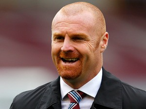 Burnley manager Sean Dyche smiles during his team's match against QPR on October 26, 2013