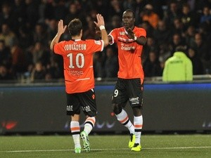 Lorient's forward Vincent Aboubakar and Lorient's French midfielder Mathieu Coutadeur jubilate after scoring during the French L1 football match Lorient vs Sochaux on October 26, 2013