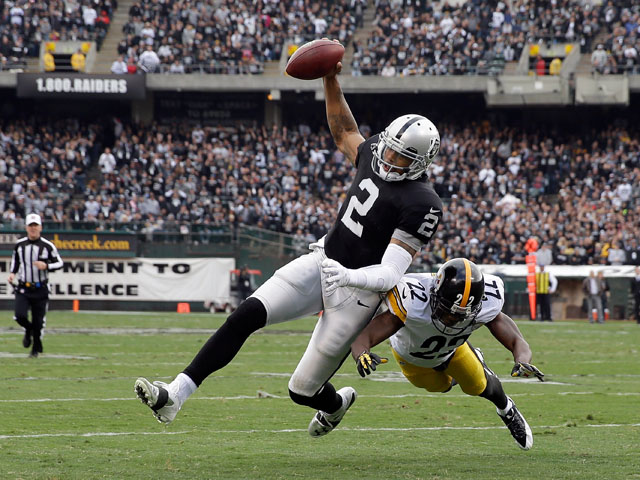 Terrelle Pryor #2 of the Oakland Raiders is tackled by William Gay #22 of the Pittsburgh Steelers at O.co Coliseum on October 27, 2013