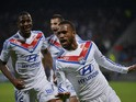Lyon's French forward Alexandre Lacazette celebrates with his teamates after scoring a goal during the French L1 football match Olympique Lyonnais (OL) vs Guingamp (EAG) on November 2, 2013