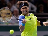 David Ferrer in action against Tomas Berdych during the quarter finals of the Paris Masters on November 1, 2013