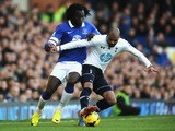 Romelu Lukaku of Everton tackles Sandro of Tottenham Hotspur during the Barclays Premier League match between Everton and Tottenham Hotspur at Goodison Park on November 3, 2013