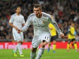 Real's Gareth Bale celebrates after scoring the opening goal against Sevilla on October 30, 2013