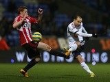 Jack Colback of Sunderland attempts to block the shot of Martin Petrov of Bolton Wanderers during the FA Cup with Budweiser Third Round match between Bolton Wanderers and Sunderland at the Reebok Stadium on January 5, 2013