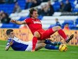 Birmingham's Callum Reilly tackles Charlton's Lawrie Wilson during their Championship match on November 2, 2013