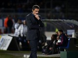Lyon's French coach Remi Garde looks on during the French L1 football match Olympique Lyonnais (OL) vs Guingamp (EAG) on November 2, 2013
